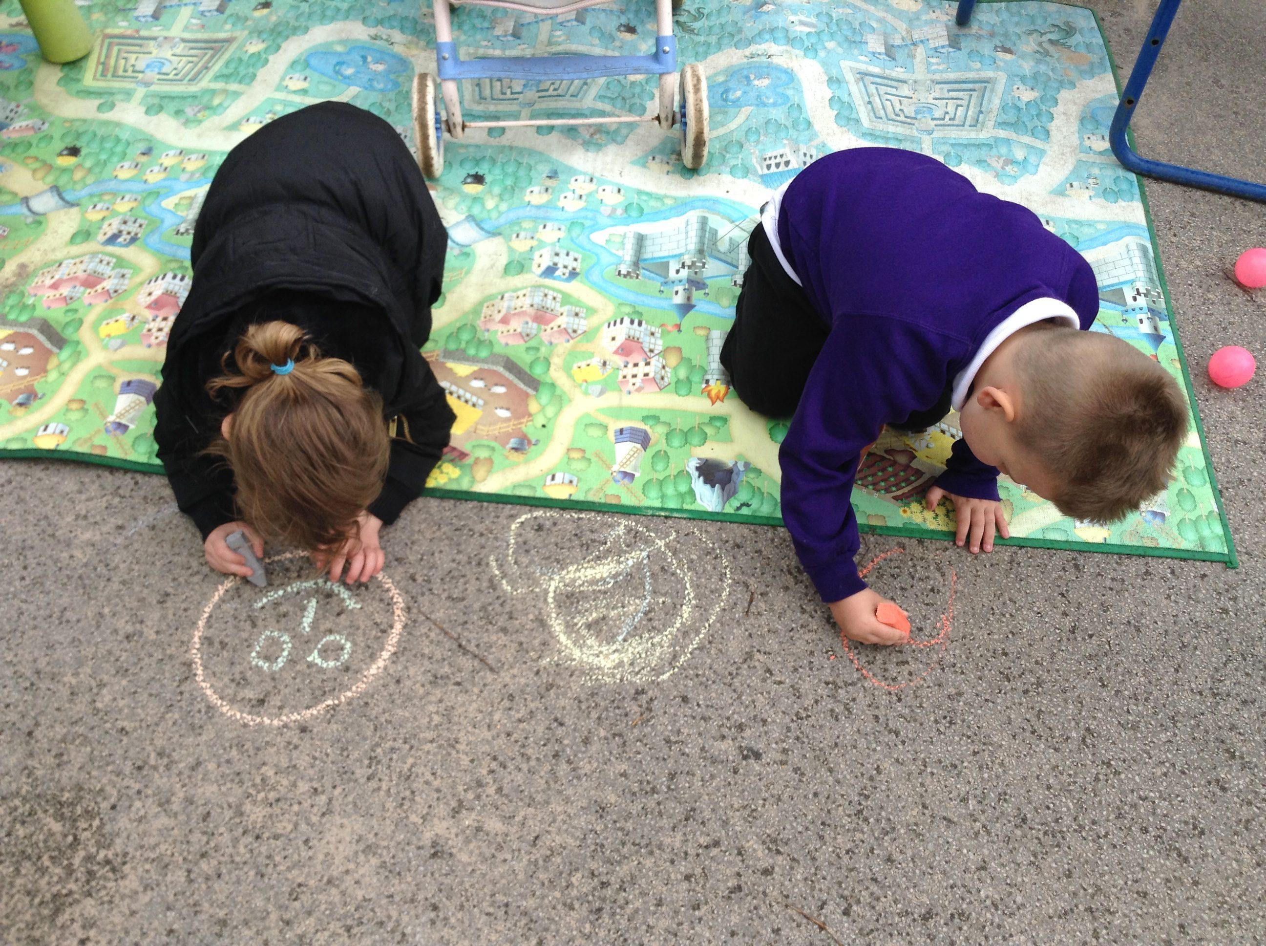 children chalking on the playground